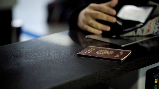 Passport of Russian Federation lies on reception desk in airport video