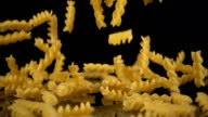 pasta falls onto a hard black surface video