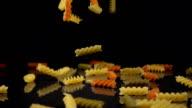 pasta falls onto a hard black surface video