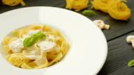 Pasta with mushrooms, basil and cream sauce video