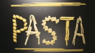 TOP VIEW: Pasta word write by several pasta types (stop motion) video
