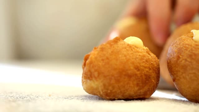 pastries filled cream with powdered sugar video