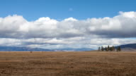 Pasture With Mountains In The Background Time Lapse video