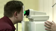 Patient at Optometrist 's office. Medical exam video