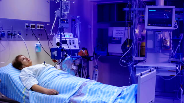 Patient is lying in the postoperative room. video