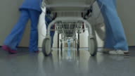 POV Patient on a stretcher being transported down the hospital hallway video