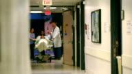 Patient on Gurney Through Doors video