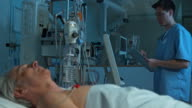 DS Patient sleeping in ICU while nurse checks on him video