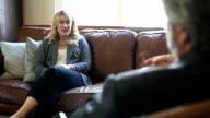 Patient talks to her therapist video