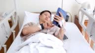 Patient using digital tablet video