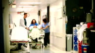 Patient Wheeled by on Gurney video