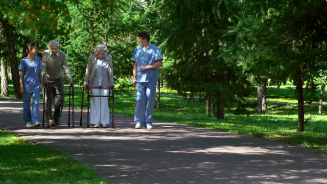 Patients with Walkers Accompanied by Caregivers video