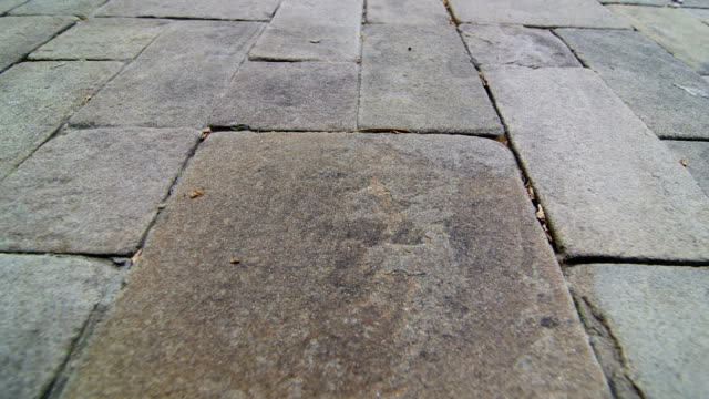 Patio garden driveway natural stone paving slab surface background video
