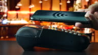 Paying by Contactless payment with Smart phone in restaurant, NFC technology to pay video