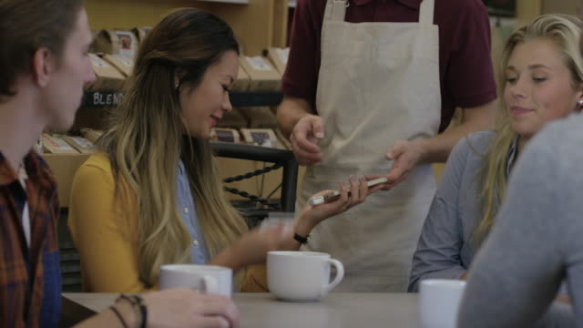 Paying for Coffee Using a Credit Card on a Mobile Phone video