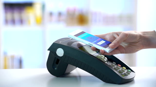 paying through smartphone using NFC technology. Slow motion video