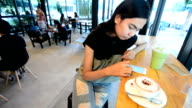 Paying With NFC Technology on Smart Phone in Coffee Shop video