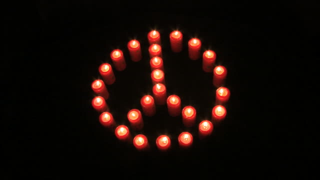 peace symbol made with burning candles video
