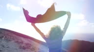 peaceful and happy woman with raised arms in the wind: freedom, summer video
