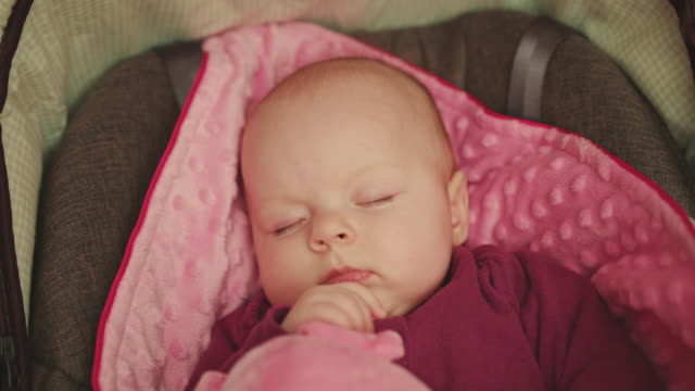 Peaceful Baby Sleeping in a Car Seat video