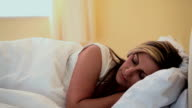 Peaceful woman sleeping in her bed video