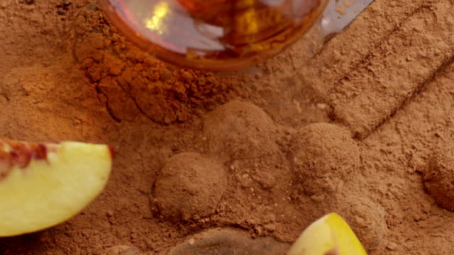 Peach falling into cacao. Slow motion. Shot on RED EPIC Cinema Camera. video