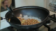 Peanuts in a frying pan video