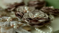 Pearl jewelry and flowers video