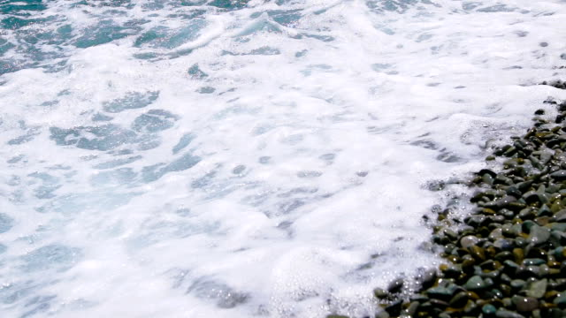 Pebble beach and sea. The waves rolled on shore video