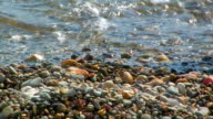 Pebbles and the sea. video