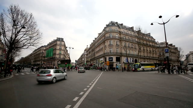HD: Pedestrian Commuter Crowd Crossing at Haussmann Lafayette Paris, France video