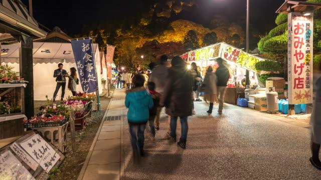 Pedestrian crowded at korankei flea market Nagoya at night Japan video