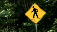 Pedestrian sign on country road. video