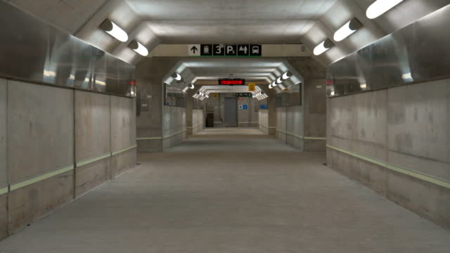 Pedestrian underground tunnel below train station video