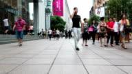 Pedestrian walking in modern street in shanghai ,time lapse. video