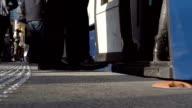 Pedestrians at a bus station video