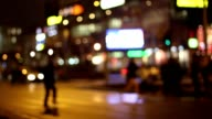 Pedestrians at night in a city video