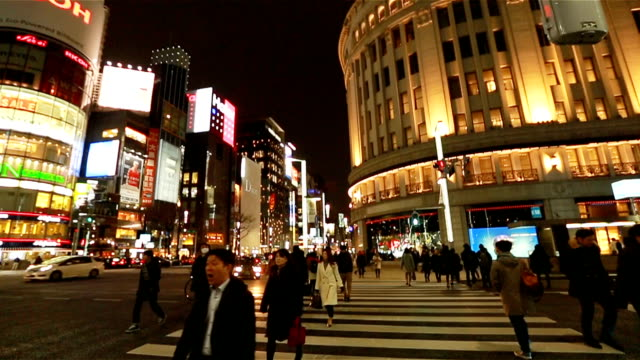 Pedestrians cross at Ginza Crossing video