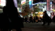 HD: Pedestrians cross at Shibuya Crossing night video