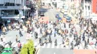HD: Pedestrians cross at Shibuya Crossing video