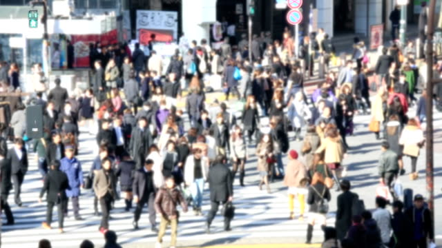 HD: Pedestrians cross at Shibuya Crossing video
