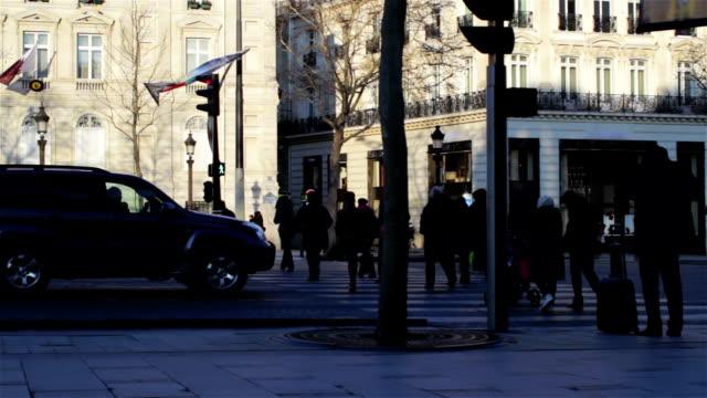 Pedestrians crossing street, France video