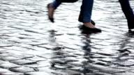 Pedestrians going on wet sett video