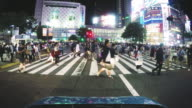 Pedestrians walk across Tokyo Shibuya Crossing video