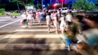 pedestrians walking at zebra crossing in urban city guangzhou street,time lapse. video