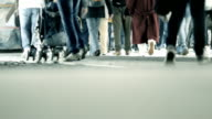 Pedestrians walking fast in the city by night video