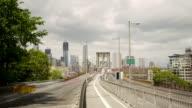 Pedestrians walking over Brooklyn Bridge. Timelapse video