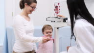 Pediatrician weighing one year old girl video