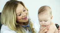 Pediatrician with cute baby girl video