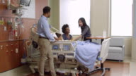 Pediatrician With Parents And Child In Hospital Shot On R3D video